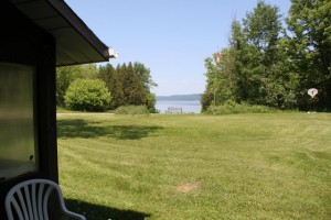 Lakeside residential home for sale. Front yard on the lake.